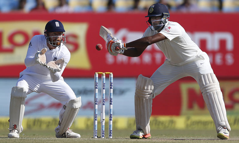 Indian batsman Ravichandran Ashwin bats on the fourth day of the first cricket test match between India and England, in Rajkot, India, on Saturday, November 12, 2016. Photo: AP