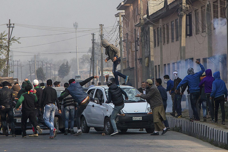Kashmiri protesters smash windshields of private cars for ignoring separatist-sponsored strike during the funeral of Qaiser Sofi in Srinagar, Indian controlled Kashmir on Saturday, November 5, 2016.Photo: AP