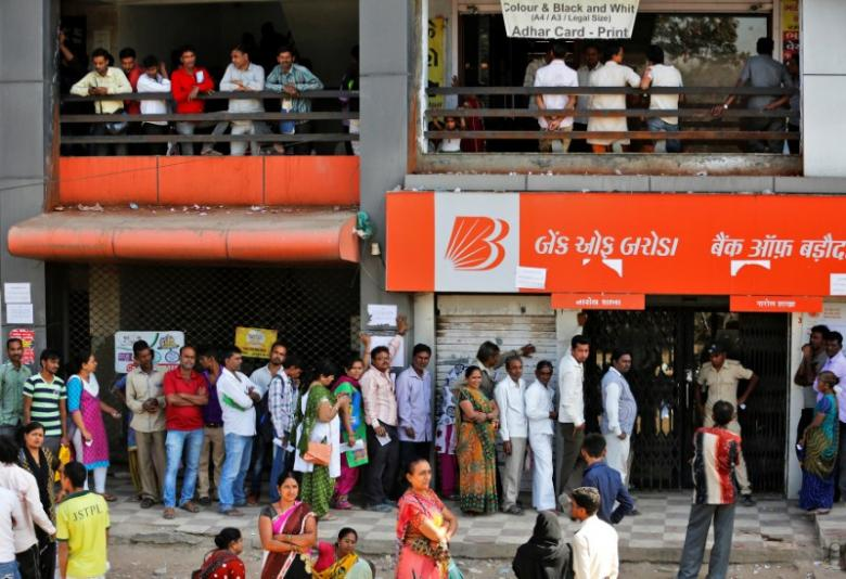 People queue to deposit or withdraw cash outside a bank on the outskirts of Ahmedabad, India, November 29, 2016. REUTERS/Amit Dave