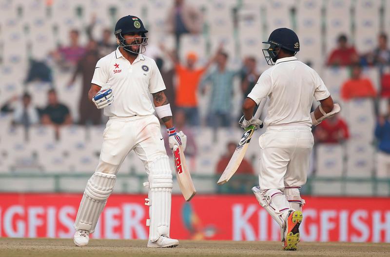 India's Virat Kohli and Parthiv Patel (R) celebrate after winning the match. Photo: Reuters