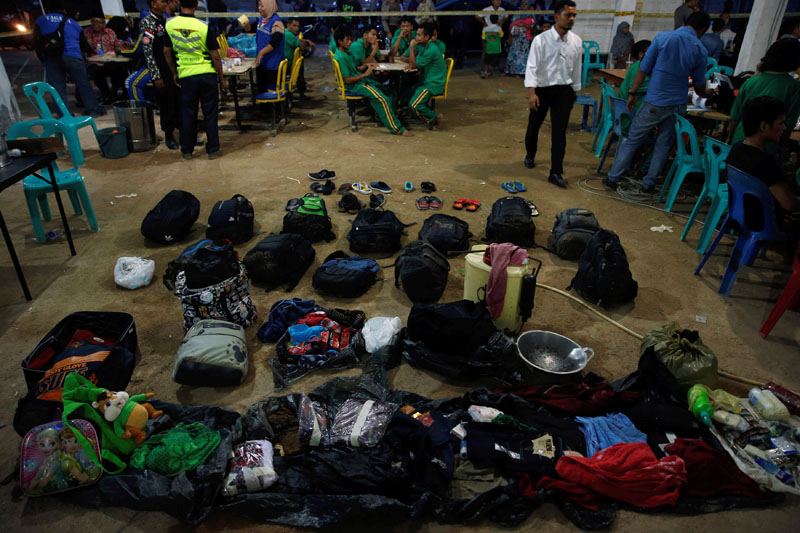 Belongings of survivors are laid out at a temporary holding area after their boat capsized off Batam, in Nongsa, Batam, Indonesia on November 2, 2016. Photo: Reuters