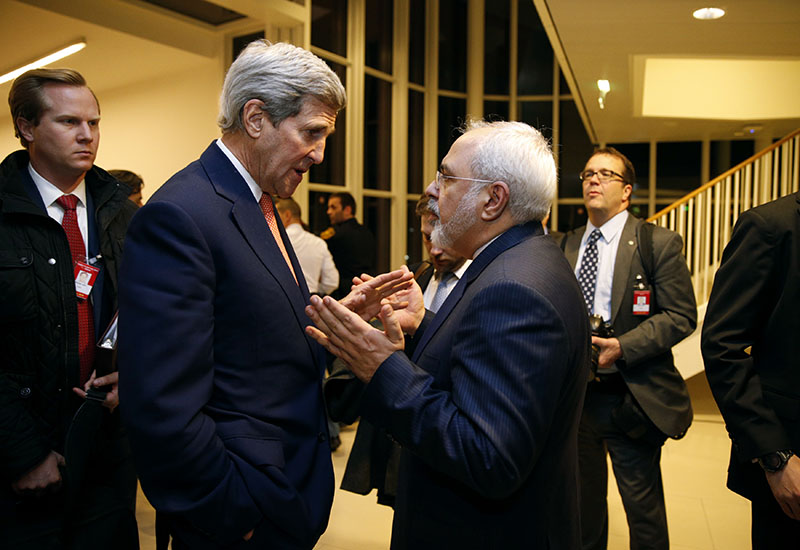FILE - Secretary of State John Kerry talks with Iranian Foreign Minister Mohammad Javad Zarif in Vienna, after the International Atomic Energy Agency (IAEA) verified that Iran has met all conditions under the nuclear deal, on January 16, 2016. Photo: Kevin Lamarque/Pool via AP
