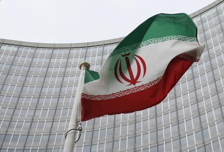 An Iranian flag flutters in front of the International Atomic Energy Agency (IAEA) headquarters in Vienna, Austria, January 15, 2016.   REUTERS/Leonhard Foeger/Files