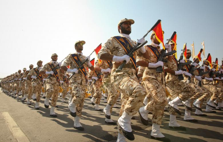 FILE PHOTO: Members of the Iranian revolutionary guard march during a parade to commemorate the anniversary of the Iran-Iraq war (1980-88), in Tehran, Iran, September 22, 2011. REUTERS/Stringer/File Photo