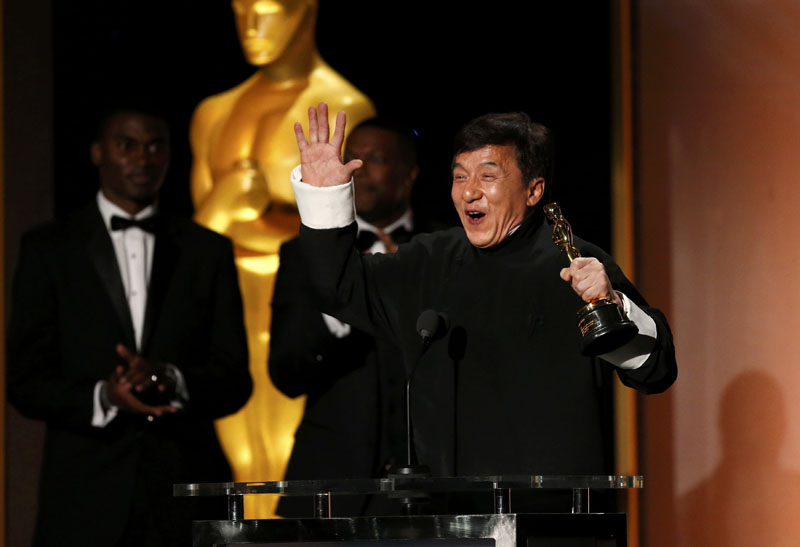 Actor Jackie Chan reacts as he accepts his Honorary Award as actor Chris Tucker (centre) looks on at the 8th Annual Governors Awards in Los Angeles, California, US, on November 12, 2016. Photo: Reuters