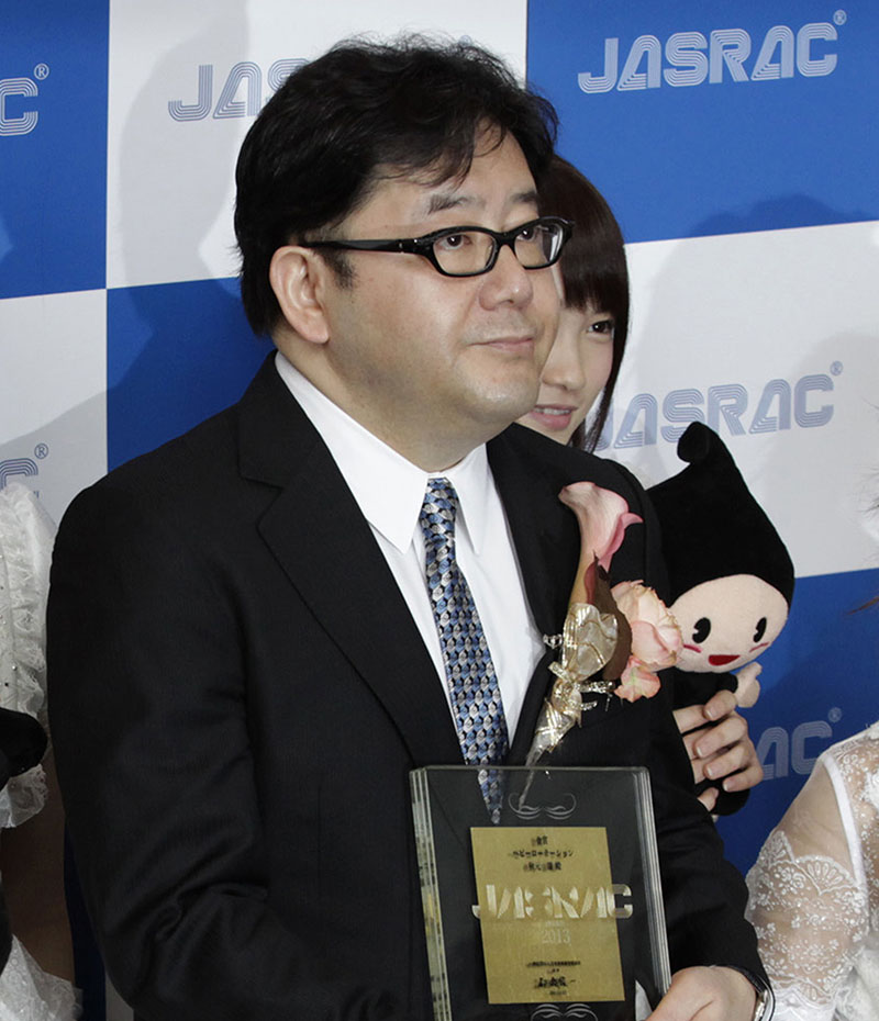 FILE - Yasushi Akimoto poses for photographers during JASRAC (Japanese Society for Rights of Authors, Composers and Publishers) music award in Tokyo, on May 22, 2013. Photo: AP