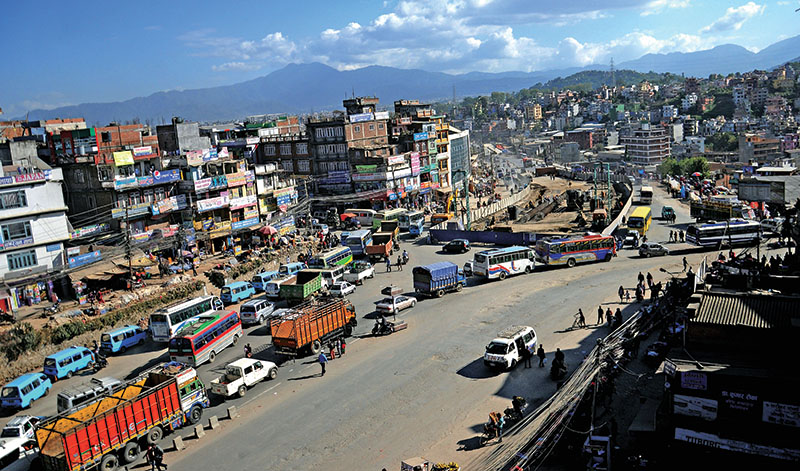 Vehicles preparing to exit from Kalanki Chowk, in Kathmandu, on Sunday, November 6, 2016. An underpass is seen under-construction in the middle of Ring Road as part of the governmentu2019s road expansion drive to ease traffic congestion in Kathmandu Valley. Photo: Balkrishna Thapa Chhetri/THT