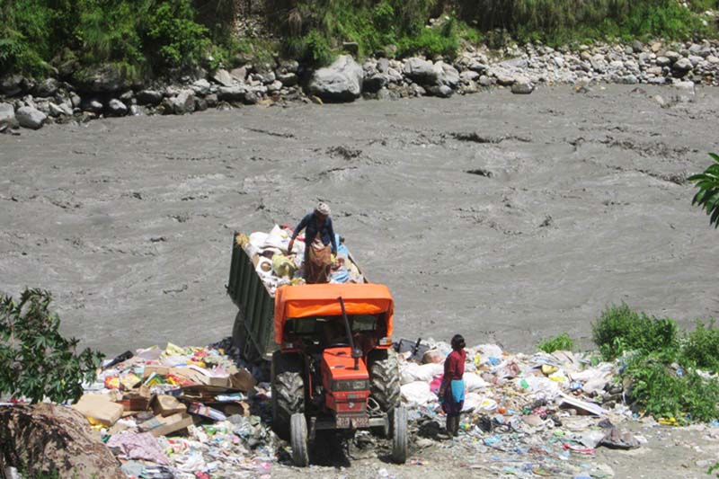 Garbage is thrown into the Kaligandaki River in Beni of Myagdi district, on Sunday, November 6, 2016. For the want of a well-managed dumping site, the river, revered by Hindus, is being polluted day by day. Photo: RSS