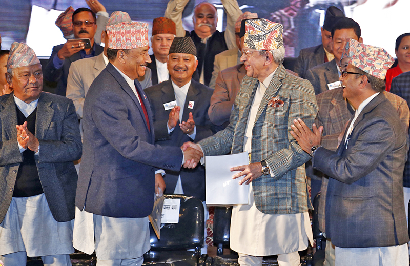 Rastriya Prajatantra Party and Rastriya Prajatantra Party-Nepal leaders Pashupati Shamsher Rana and Kamal Thapa shaking hands during the announcement of  the unification of the two parties,  at Academy Hall, in Kathmandu, on Monday, November 21, 2016. Photo: THT
