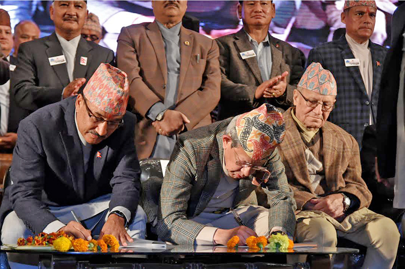 Rastriya Prajatantra Party-Nepal Chairman Kamal Thapa (left) and Rastriya Prajantra Party Chairman Pashupati Shamsher Rana sign an agreement for party unification in Kathmandu, on Monday, November 21, 2016. Photo: RSS