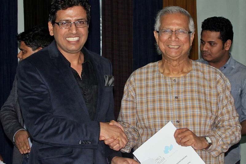 Director of King's College, Narottam Aryal, and Nobel Laureate and Chairman of the Yunus Centre, Prof Dr Mohammad Yunus shake hands after signing a new deal, in Kathmandu, on Tuesday, November 22, 2016. Photo Courtesy: King's College