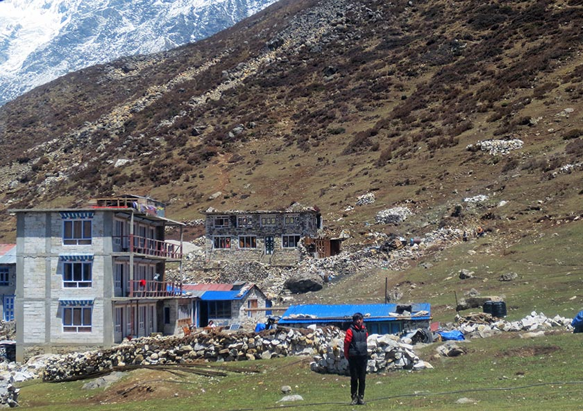 A man stands in an open space in Kyanjin Gumba in Langtang region of Rasuwa district in Nepal on April 25, 2016, one year after the devastating earthquake. Photo: Keshav P. Koirala