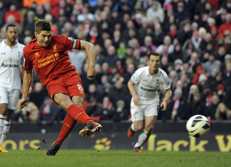 FILE - In this Sunday March 10, 2013 file photo, Liverpool's Steven Gerrard scores the third and winning goal of the game for his side from the penalty spot during their English Premier League soccer match against Tottenham Hotspur at Anfield, Liverpool. Photo: AP