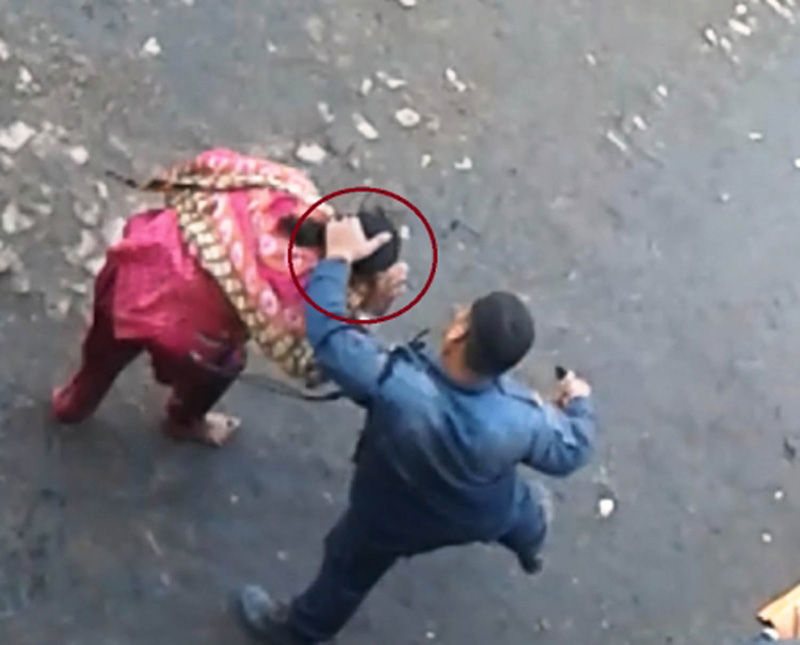A photo on social network site of a woman being thrashed by a policeman, at Rajat Chowk of Inarwa, in Birgunj, Parsa. The manhandling took place last Wednesday, November 9, 2016.