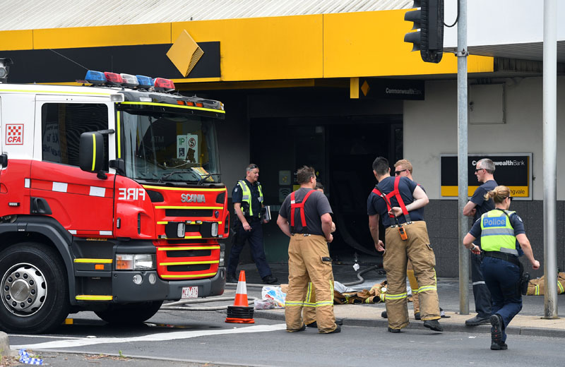 Emergency service workers are seen at a branch of the Commonwealth Bank after a fire injured customers in Melbourne, Australia, on November 18, 2016. Photo: AAP via Reuters