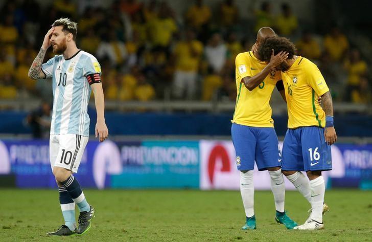 Football Soccer - Brazil v Argentina - World Cup 2018 Qualifiers - Mineirao stadium, Belo Horizonte, Brazil - 10/11/16 - Argentina's Lionel Messi (10) reacts next to Brazil's Fernandinho and Marcelo (R).  REUTERS/Cristiane Mattos