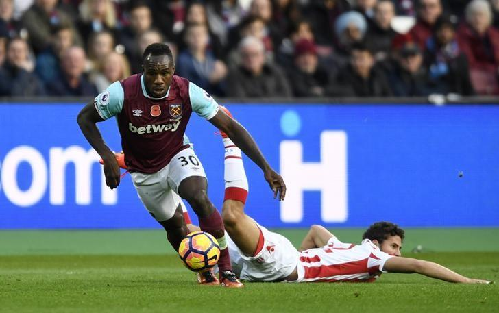 Britain Football Soccer - West Ham United v Stoke City - Premier League - London Stadium - 16/17 - 5/11/16 West Ham United's Michail Antonio in action with Stoke City's Ramadan Sobhi  Action Images via Reuters / Tony O'Brien