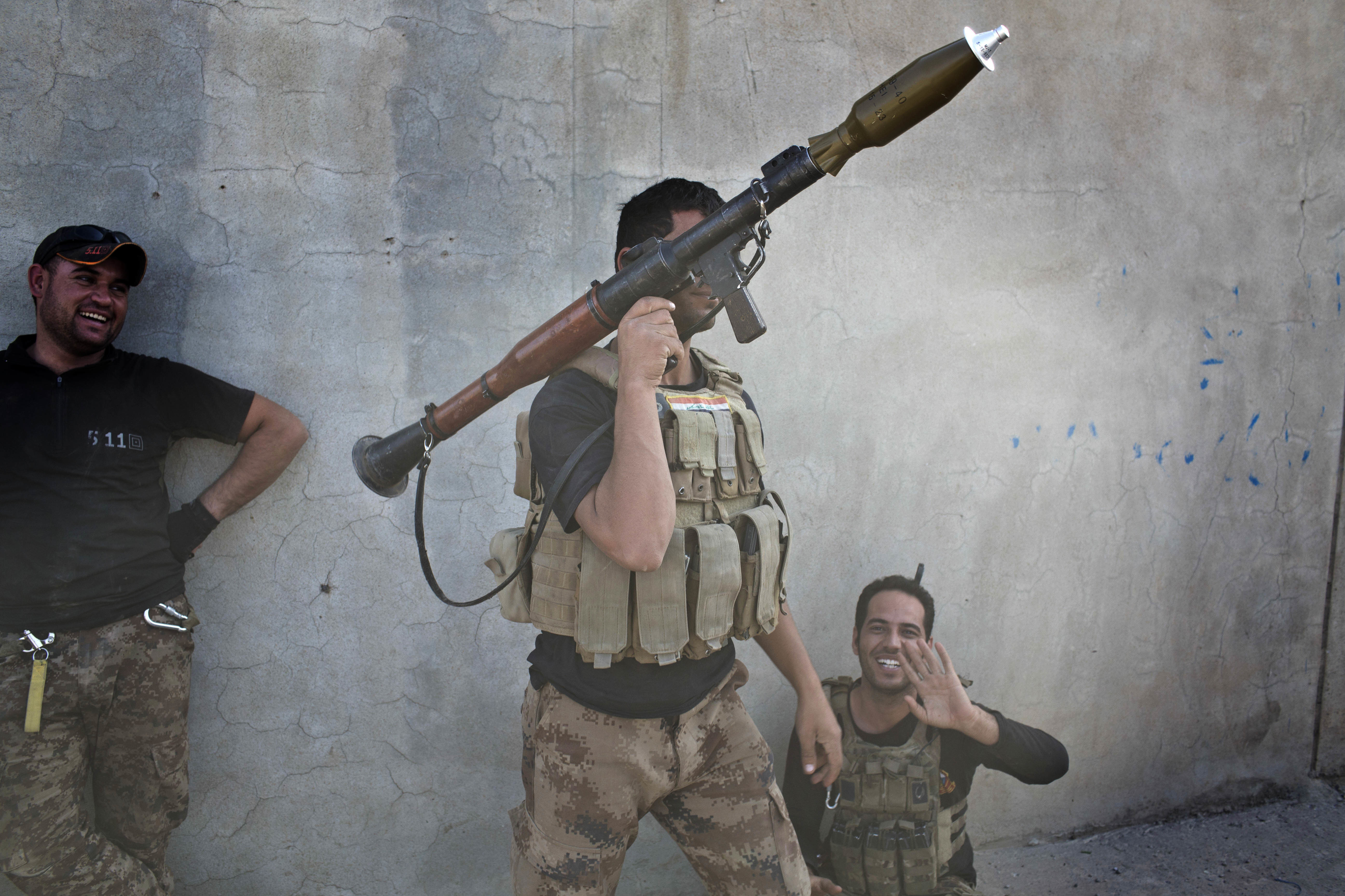 An Iraqi special forces soldier holds a rocket propelled grenade launcher in Bazwaya, some 8 kilometers from the center of Mosul, Iraq, Monday, Oct. 31, 2016. Iraqi special forces stood poised to enter Mosul in an offensive to drive out Islamic State militants after sweeping into the last village on the city's eastern edge Monday while fending off suicide car bombs without losing a soldier. (AP Photo/Marko Drobnjakovic)