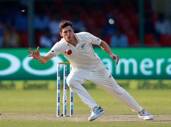Cricket - India v New Zealand - First Test cricket match - Green Park Stadium, Kanpur, India - 22/09/2016. New Zealand's Mitchell Santner attempts to field the ball.  REUTERS/Danish Siddiqui/Files