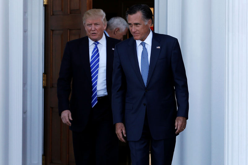 US President-elect Donald Trump (left) and former Massachusetts Governor Mitt Romney emerge after their meeting at the main clubhouse at Trump National Golf Club in Bedminster, New Jersey, US, on November 19, 2016. Photo: Reuters