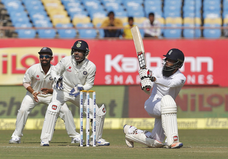 England's Moeen Ali (R) watches the ball after playing a shot as India's wicketkeeper Wriddhiman Saha (C) and Ajinkya Rahane look on. Photo: Reuters
