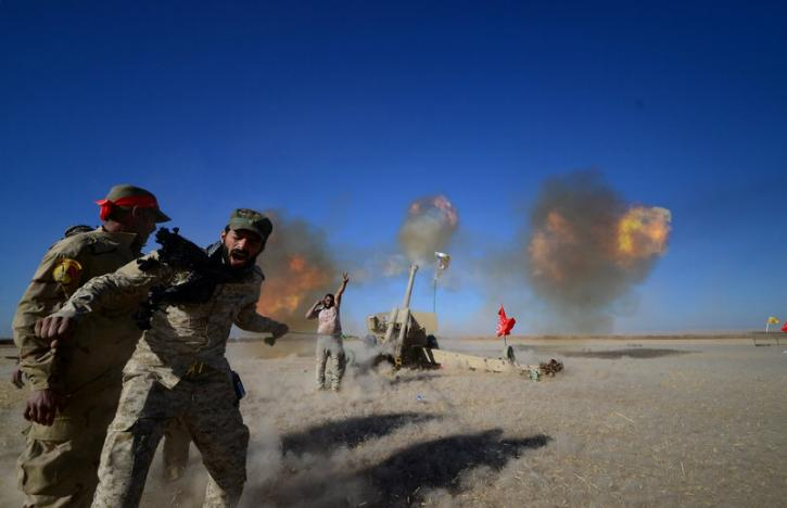 Shi'ite fighters fire artillery towards Islamic State militants during a battle with Islamic State militants on the outskirt of Tal Afar west of Mosul, Iraq, November 18, 2016. REUTERS/Stringer