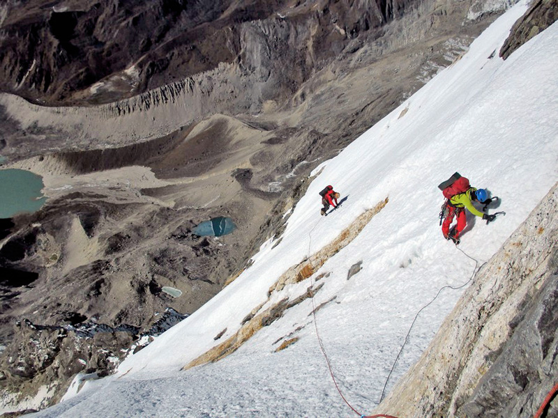 File photo of Mountaineers Roger and Santi ascending towards the Karyolung summit. Photo Courtesy: Santi Padros