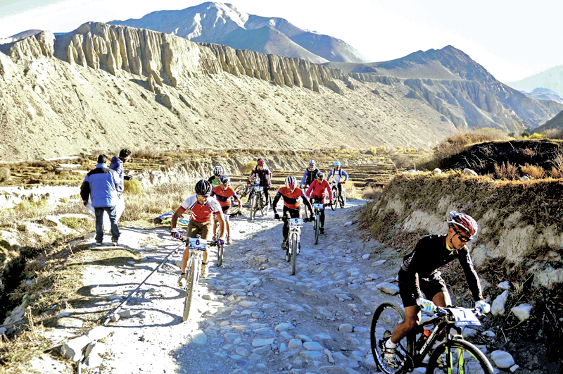 Participants of the Mustang Madness riding mountain bikes during the first stage of the cross country race that kicked off in Kagbeni on Thursday, November 24, 2016. Photo Courtesy: Adventure Sports Nepal