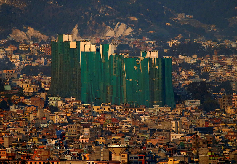 Apartment buildings damaged during the 2015 earthquake are covered with green cloth in Kathmandu on Friday November 11, 2016. Photo: REUTERS