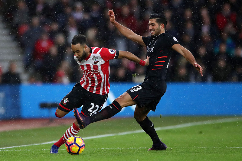 Southampton's Nathan Redmond, left, and Liverpool's Emre Can battle for the ball during the English Premier League soccer match at St Mary's Stadium, Southampton, England, on Saturday, November 19, 2016. Photo: Nick Potts/PA via AP
