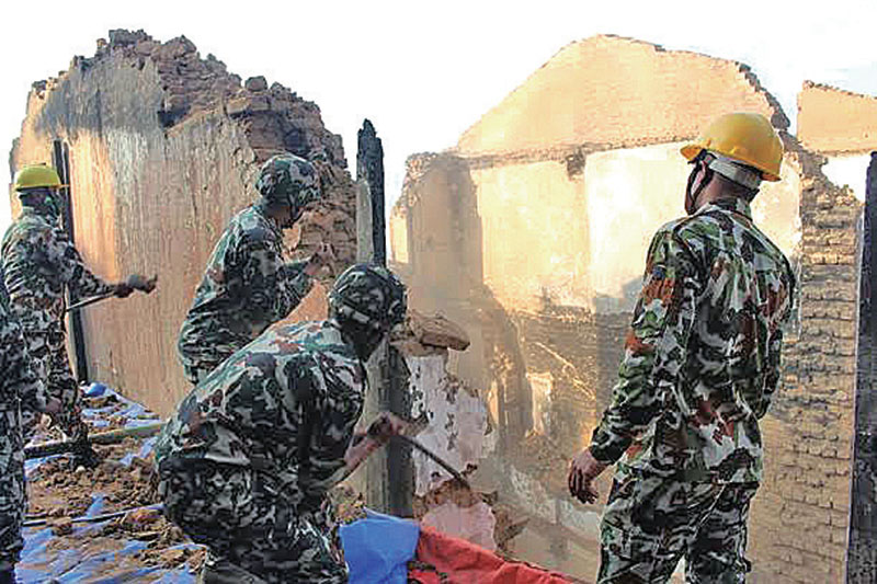 Nepal Army personnel clearing the remains of houses destroyed in a fire last week, in Bhojpur, on Saturday, November 26, 2016. Photo: THT