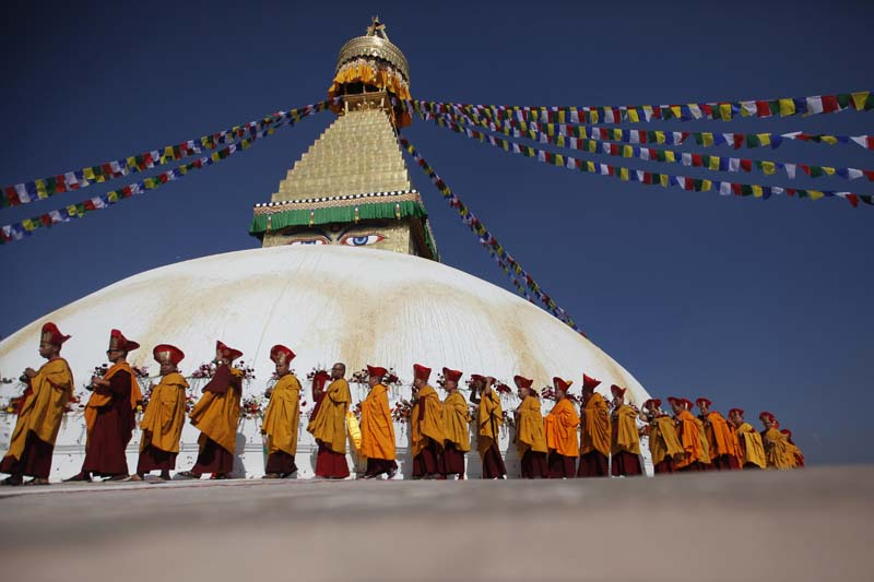 Buddhist monks circle around the Boudhanath Stupa during during the final day of its purification ceremony in Kathmandu, Nepal, on Sunday, November 20, 2016. Photo: AP