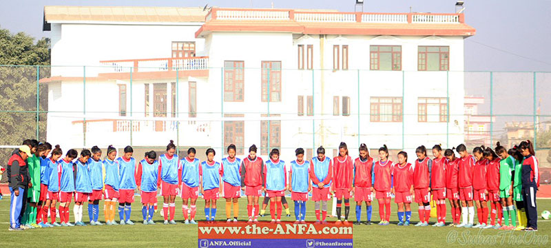 Nepal Women's National Football team observes a minute's silence for the victims of the plane crash in Colombia ahead of training session, on Wednesday, November 30, 2016. Photo: ANFA