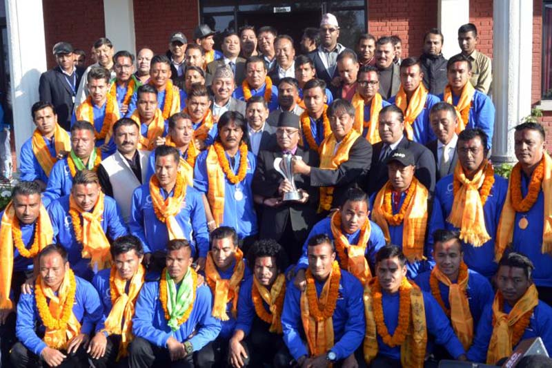 Members of the Nepal national football team pose for a photograph with Prime Minister Pushpa Kamal Dahal, in Kathmandu, on Thursday, November 17, 2016. PM Dahal honoured the team for winning the AFC Solidarity Cup, on the occasion. Photo: PM's Secretariat