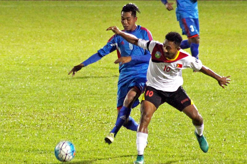 Nepal's Aditya Chaudhary (left) vies for the ball with Timor Leste's Henrique Cruz during their AFC Solidarity Cup match at the Stadium Negeri in Kuching, Malaysia, on Saturday, November 5, 2016. Photo Courtesy: ANFA