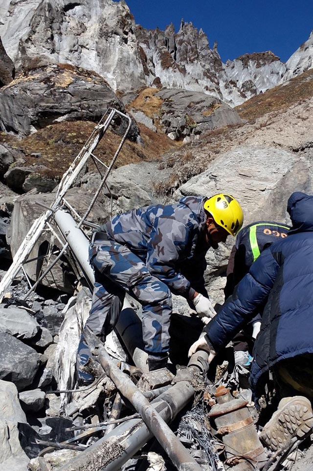 Armed Police Force personnel inspecting the wreckage of ultralight aircraft that went missing in the mountains of Kaski district on October 8, 2015 after it was discovered in Machhapuchhre VDC on Sunday, November 13, 2016. Photo Courtesy: APF