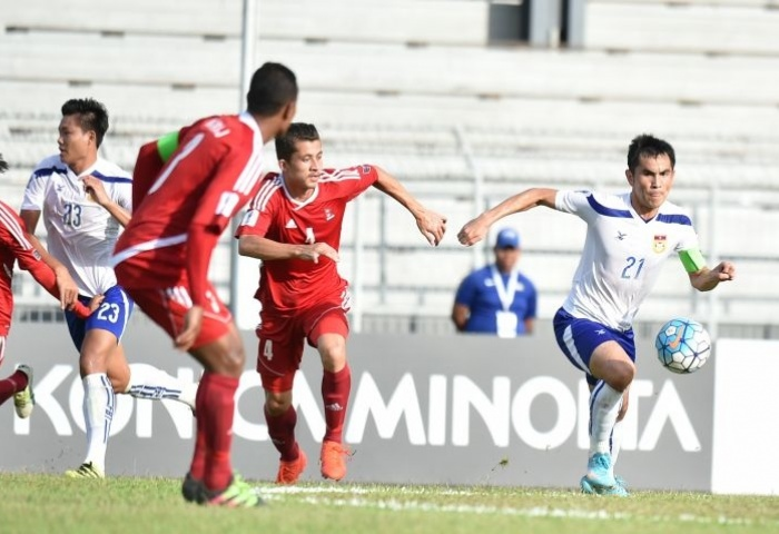 Players of Nepal and Laos vie for ball in their semifinal match of AFC Solidarity Cup. Photo: AFC