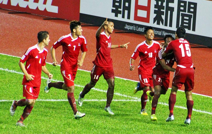 Nepali players celebrate after Sujal Shrestha scores against Macau in the first half of the AFC Solidarity Cup final in Malaysia. Photo: NSJF