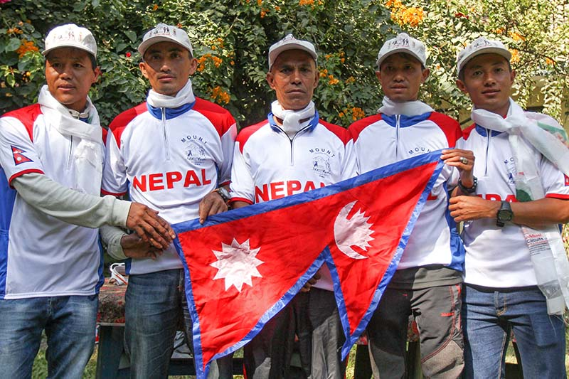 Nepali athletes pose for a photo with marathon legend Baikuntha Manandhar (centre) at their farewell programme in Lalitpur on Saturday, November 12, 2016. The team will leave for Hong Kong on Sunday to participate in the Oxfarm Trail-walker, a 100km fundraising event slated for November 18. Photo: Uditp Singh Chhetry / THT