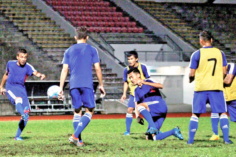 Nepali national football team members take part in training in Kuching, Malaysia on Wednesday, on the eve of their AFC Solidarity Cup Group A match against Timor Leste. Photo Courtesy: ANFA