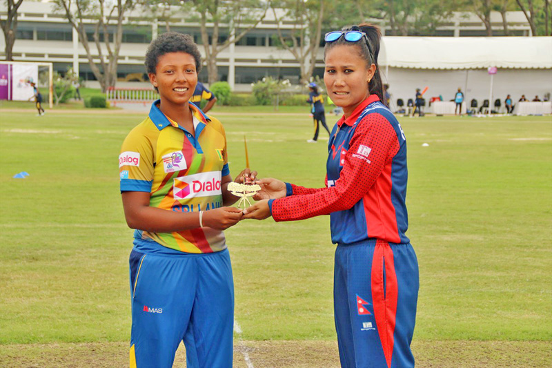 Nepal Women's National Cricket team captain Rubina Chhetry presents a souvnir to her Sri Lankan counterpart before the game during the Women's Asia Cup 2016 in Thailand, on Monday, November 28, 2016. Photo Courtesy: Raman Shiwakoti