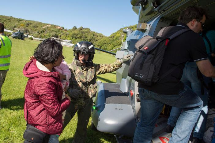 A Royal New Zealand Air Force NH90 helicopter arrives in Kaikoura on the South Island of New Zealand November 15, 2016, to evacuate those stranded following the recent earthquakes. Sgt Sam Shepherd/Courtesy of Royal New Zealand Defence Force/Handout via REUTERS