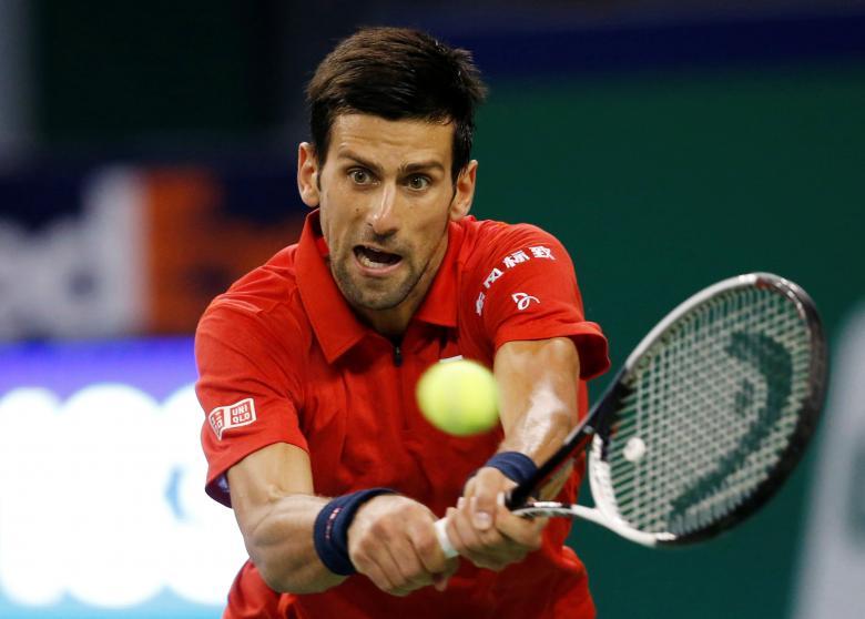 Tennis - Shanghai Masters tennis tournament - Novak Djokovic of Serbia v Roberto Bautista Agut of Spain - Shanghai, China - 15/10/16. Djokovic plays a shot. REUTERS/Aly Song