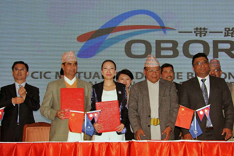Officials from Nepal and China show the signed cooperation agreements with the 'One Belt One Road' International Trade Platform, during a function held in Kathmandu, on Saturday, November 19, 2016. Photo: THT