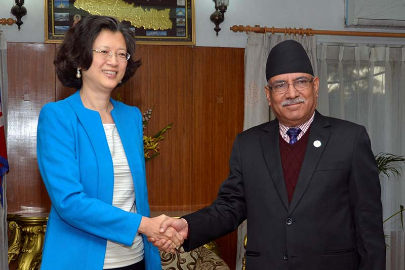 Prime Minister Pushpa Kamal Dahal shakes hands with Chinese Ambassador to Nepal Yu Hong at the former's office, in Baluwatar, on Tuesday, November 15, 2016. Photo Courtesy: PM's Secretariat