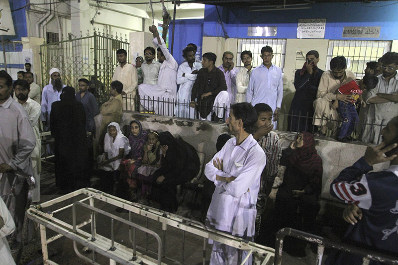 People gather outside an emergency ward of a local hospital after hearing news of a bomb blast at a Sufi shrine, in Karachi, Pakistan, on Saturday, November 12, 2016. Photo: AP