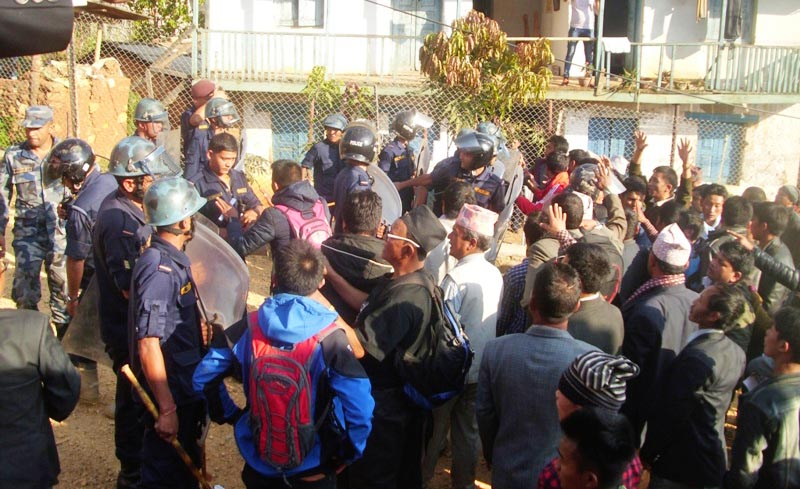 Protestors and security personnel stand face-to-face after a clash in the premises of District Development Committee in Phidim, Panchthar. Photo: Laxmi Gautam