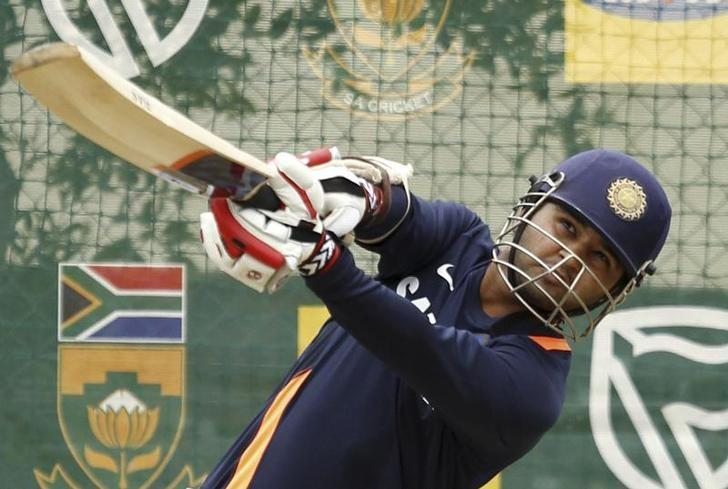 Parthiv Patel plays a shot during a practice session before their fourth one-day international cricket match against South Africa at St George's Park stadium in Port Elizabeth January 20, 2011. REUTERS/Siphiwe Sibeko/File Photo
