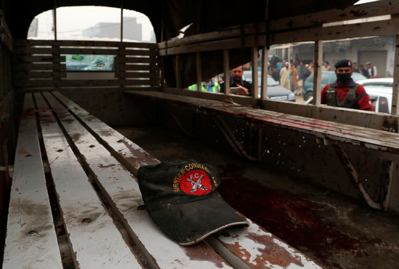 A hat remains on a bench after a blast killed three officers of the Frontier Constabulary in Peshawar, Pakistan, on November 22, 2016. Photo: Reuters