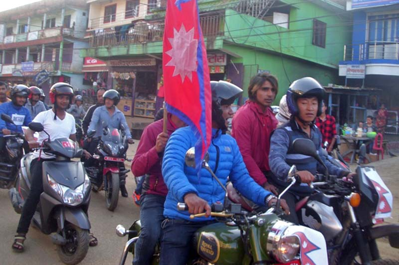 Locals of Phidim organise a motorcycle rally to celebrate Nepal's win in the AFC Solidarity Cup final against Macau, in Panchthar, on Wednesday, November 16, 2016. Photo: Laxmi Gautam/THT